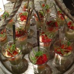 Shot glasses of smoked salmon mousse with avocado and fennel