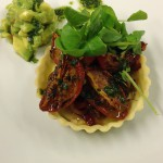 Tartlet of caramelised tomatoes and avocado salsa